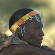 elderly man with beaded headband