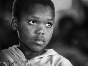 child with sad eyes