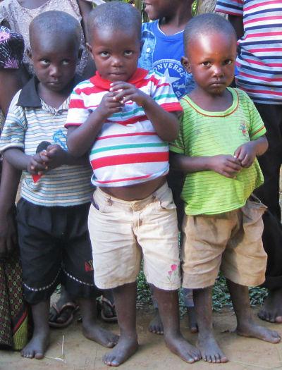 three little boys looking shy