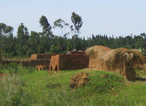 kilns and stacks of drying clay bricks