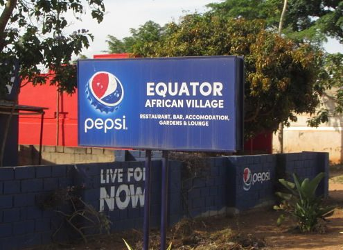 roadside sign for the Equator restaurant
